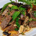 25305895 - thai food name is grilled beef with spicy salad