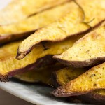 33438471 - portion of fresh baked sweet potato wedges