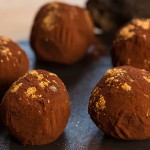 33743170 - delicious chocolate truffles with golden. selective focus