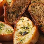 39655175 - toasted bread with herbs and garlic macro. horizontal, rustic style