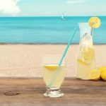52247277 - ice cold lemonade at the beach