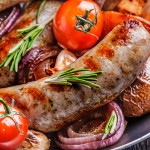 44758656 - grilled sausages and vegetables  in  rustic style. selective focus.