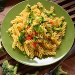 49133213 - fusilli pasta with broccoli with ingredients around
