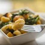 55216985 - vegetarian gnocchi dish with squash kale and mushrooms