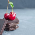 59617697 - broken slices of chocolate and cherries