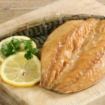 34374770 - two smoked mackerel fillets  with lemon and parsley